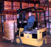 forklift operator in Piedmont Distribution's warehouse.